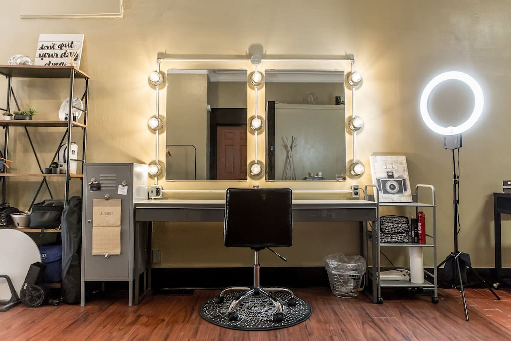 Hair and makeup vanity with multiple outlets, large counter top, and a ring light for makeup use.