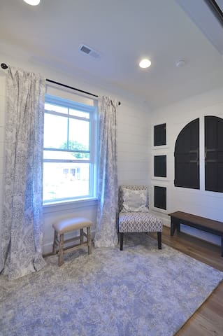 This is the sitting room/2nd bedroom. It's a versatile room. Behind those reclaimed Armoire cabinet doors is a 2nd closet and additional storage space.