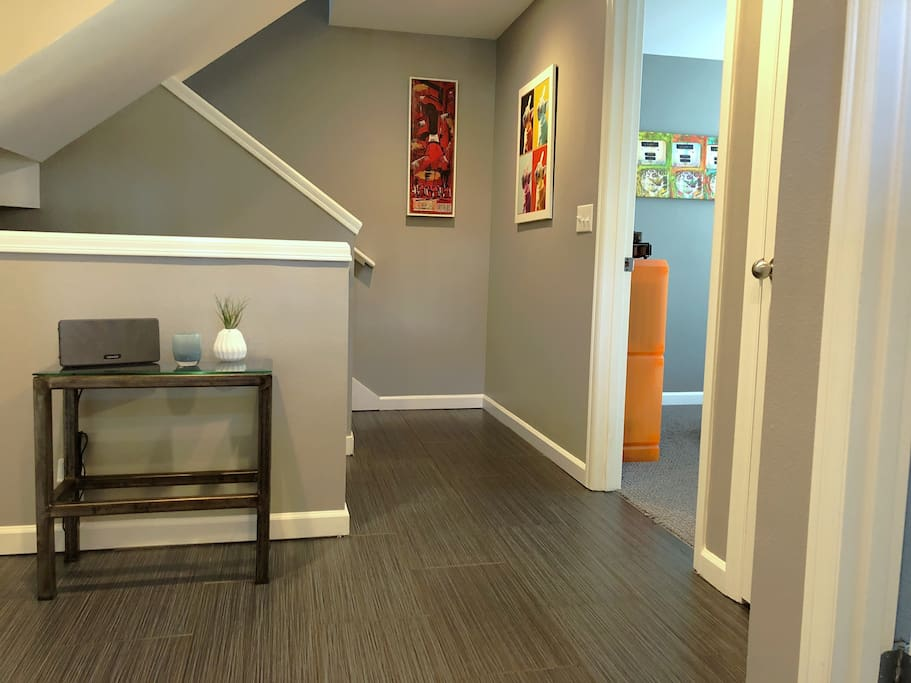 Your own floor, with a shared entrance.   As you walk in, TV room and bedroom on the right, your private bathroom to the left.