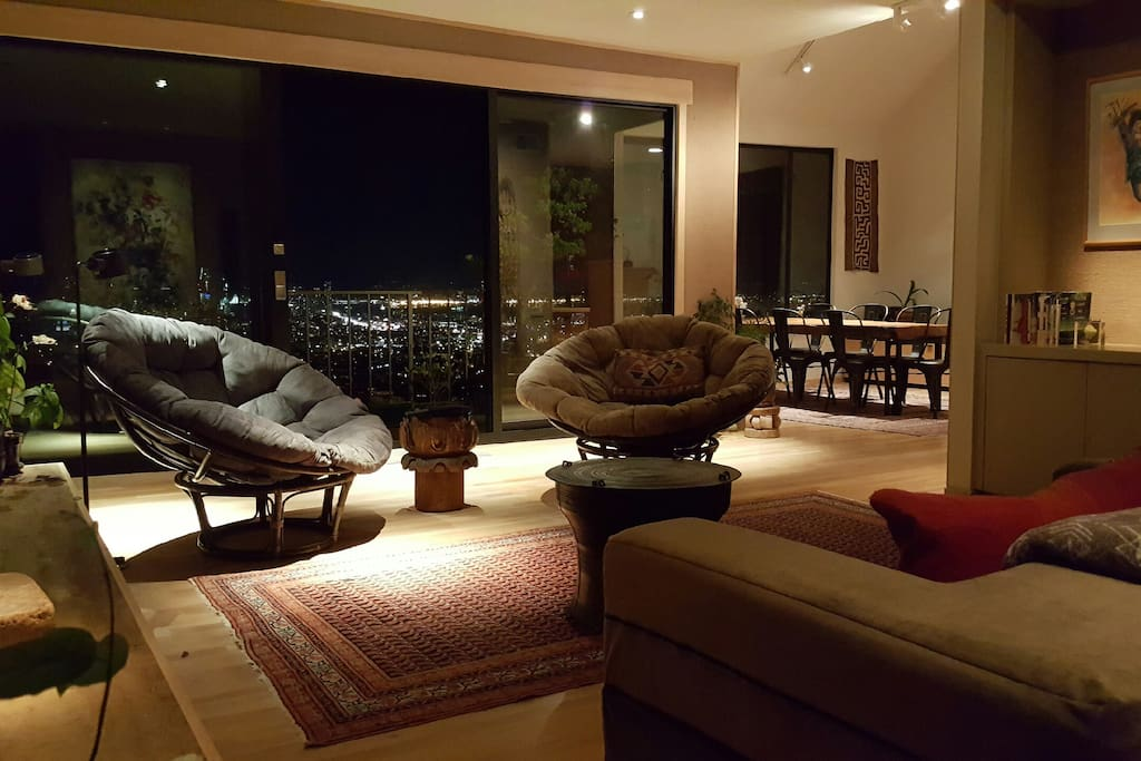The spacious living room is warm and comfortable by both night....