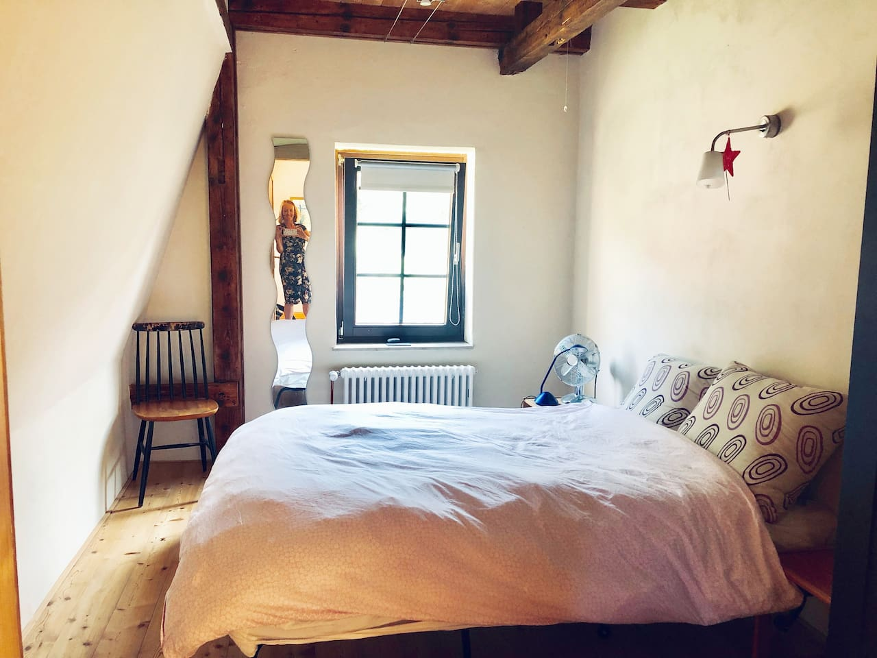 Small and cosy room awaits you!  Please note this room if you or you and your partner are 6ft (1.8m) tall try our large converted attic double bedroom instead, for more comfort.