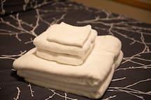 Fresh, clean bath-sized towels ready for you.