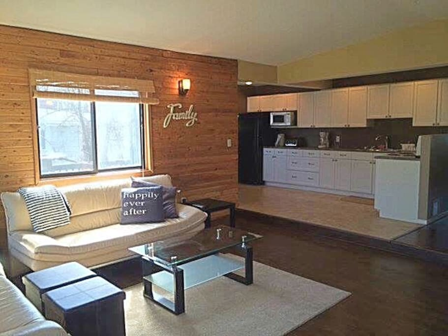 open floor plan, unique rustic feature wall