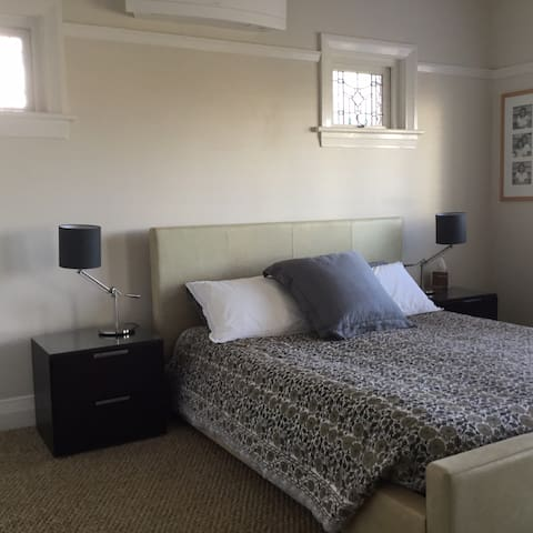 Master bedroom with Queen size European leather bed, air conditioning, ceiling fan and full built ins
