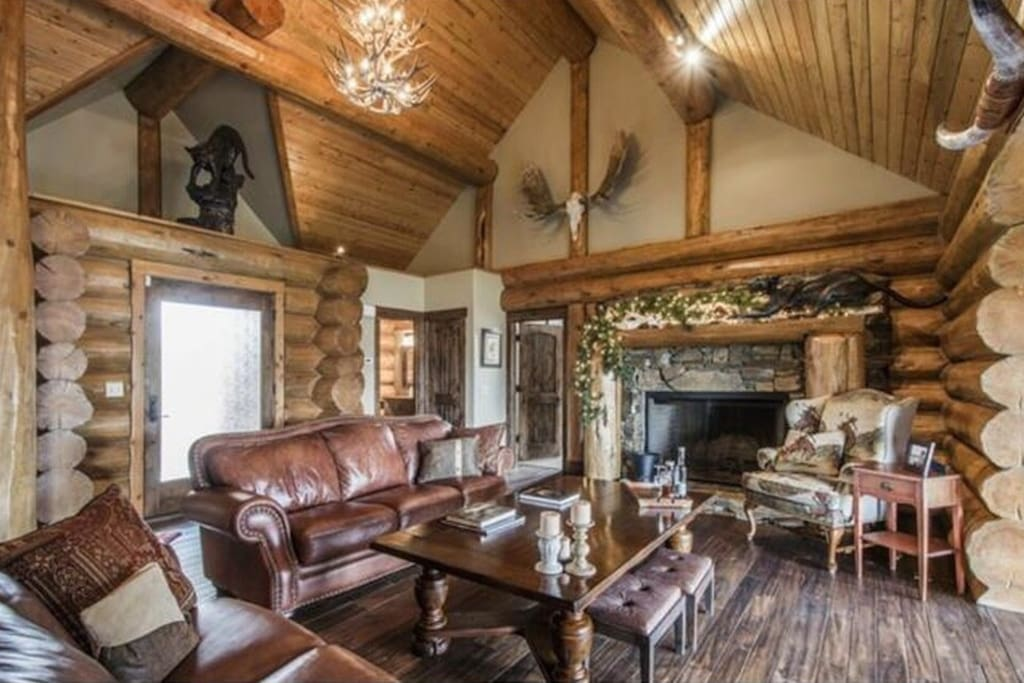 Main level living room with wood burning fire place