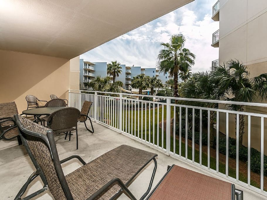 View from Master Bedroom side of balcony showing dining table and chase lounges!