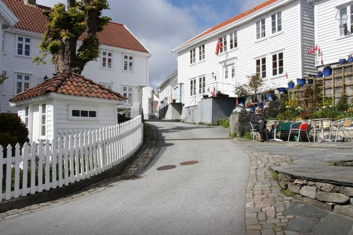 The apartment is located in the center of the old town, about 50 meters up this street.