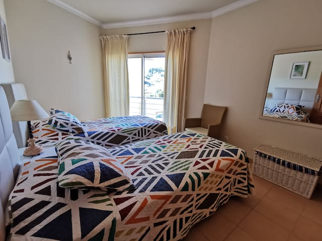 Bedroom 2 has twin beds and fitted wardrobe and small veranda with village and countryside view