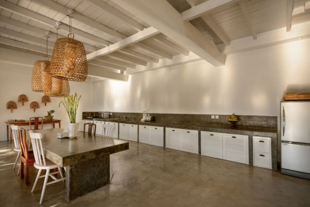 Open style kitchen with a dining table that can more than comfortably accommodate 8-10 pax.  Ideal for hosting Please note new photos to come now has subway tile, floating sheves and modern gas oven