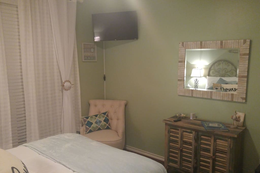 THIS LISTING ONLY: Coastal Dreams room television and mirror. The room has a USB charging station on the hutch.