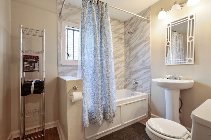 Bathroom with tub/ shower combination  includes hair dryer