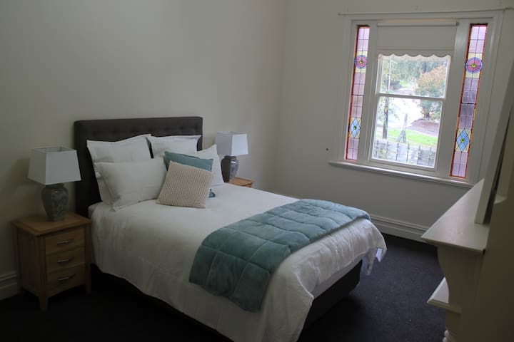 Bedroom 2 - super comfy Queen bed with quality linen.