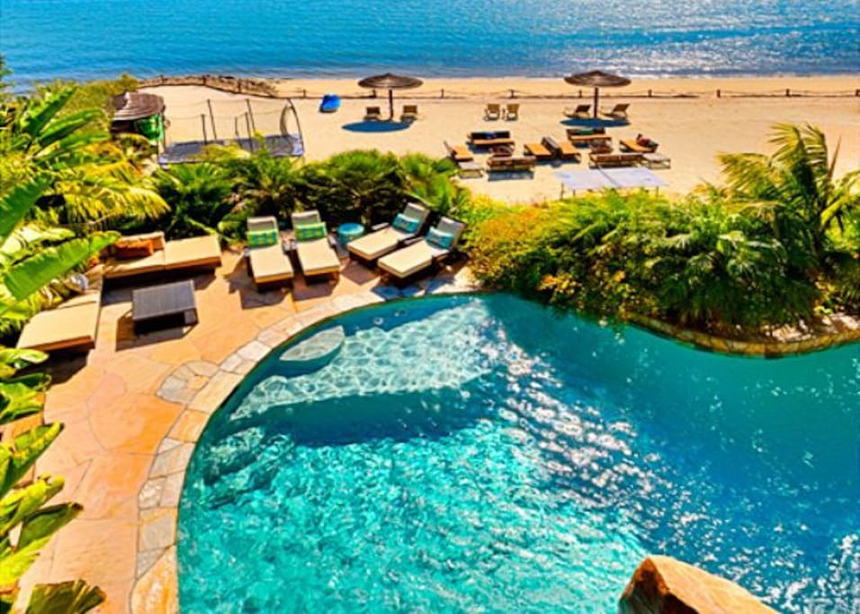 Soak in the resort style pool or stroll down to your private beach