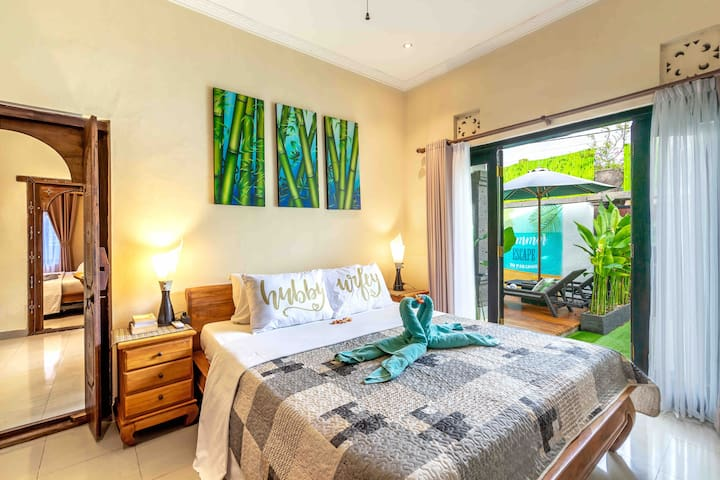 1st bedroom with a garden view and wide glass doors