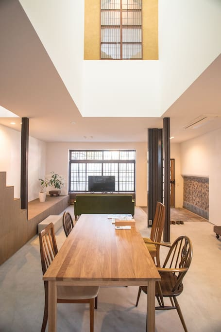 Open floorplan dining and living area with large skylight