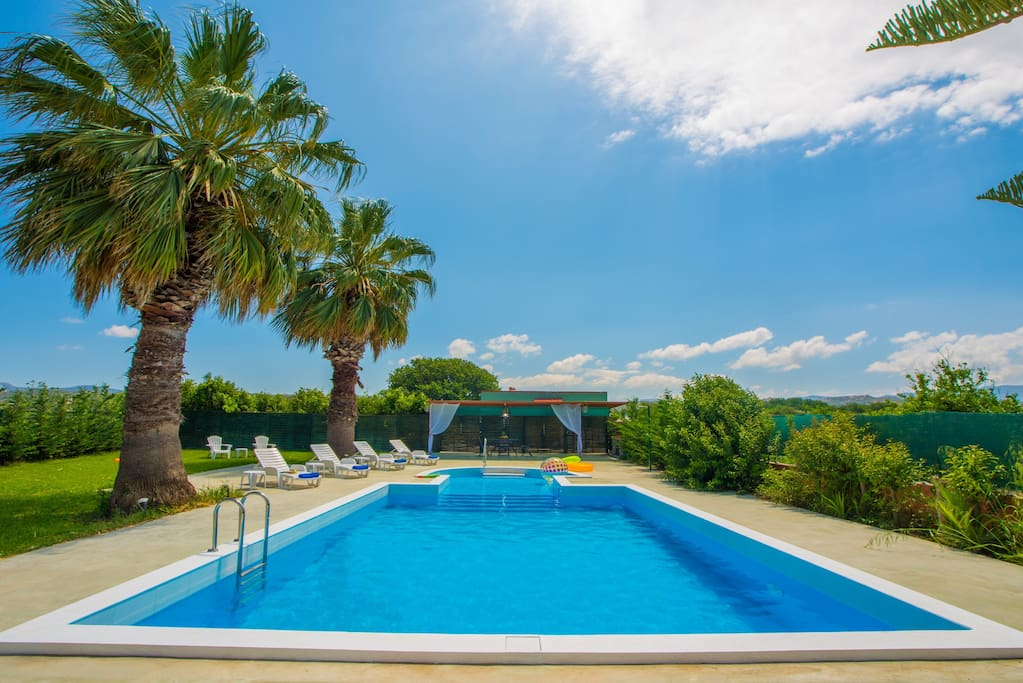 Pool area with sunbeds, shower,  barbecue facilities, dining table and toys for adults and kids!