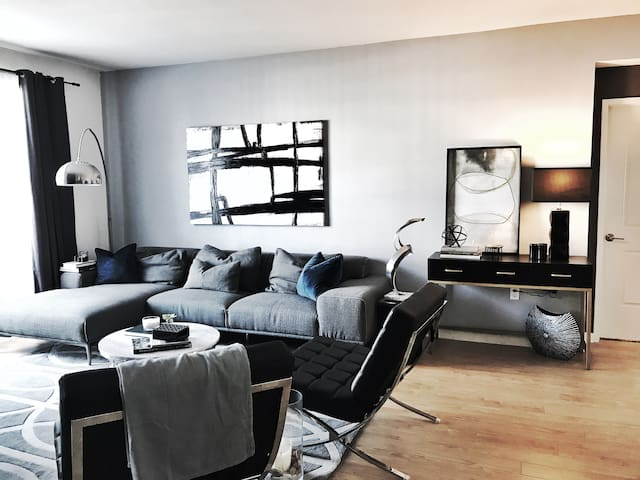 Designer living room with 65inch flat screen.