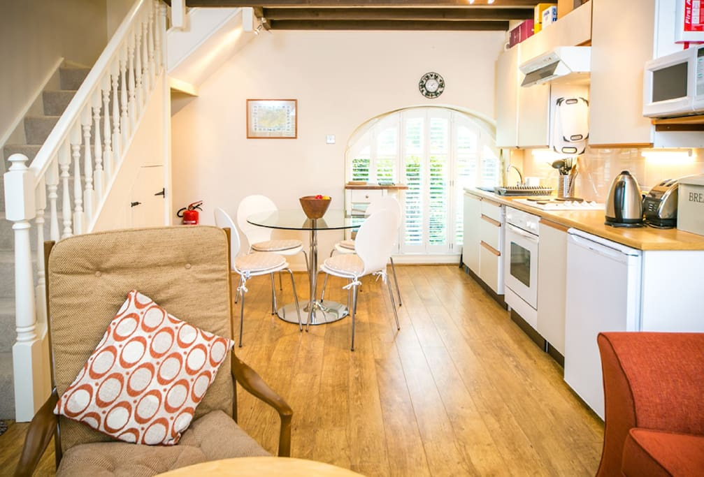 Ground floor: Open plan kitchen, sitting and dining room