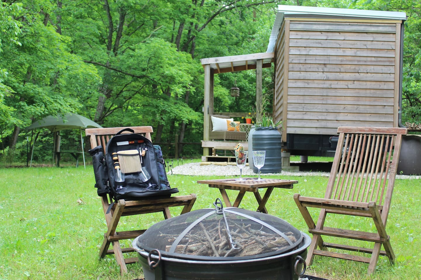 Firepit and plenty of wood just waitin' for ya!  Tiny house is accessible to destination town of Augusta, one turn, less than three miles. Be as connected as you like!