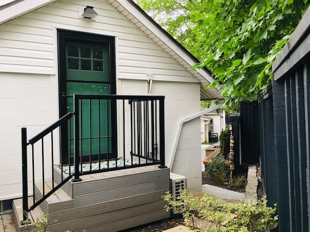 "Coming from either the backyard or the garage, here is the entrance to your ""tiny house"" studio apartment!"