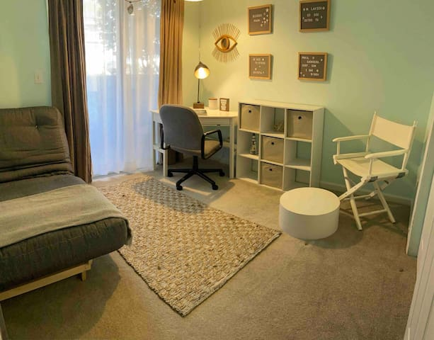 Room with office space and full size futon