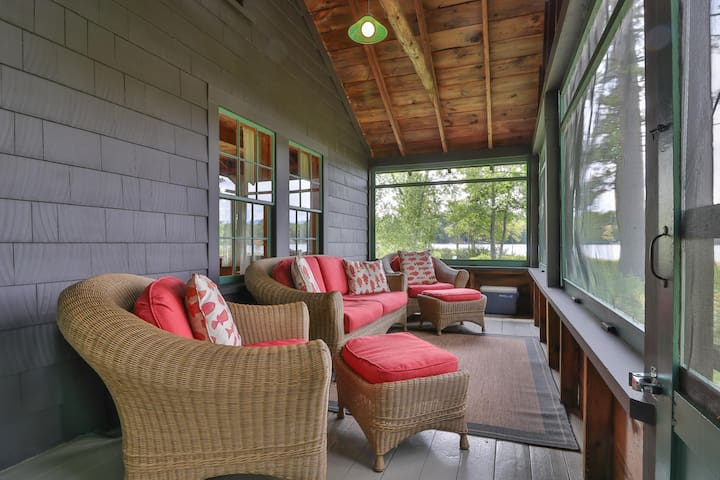 Lakefront cabin w/ private dock, canoe, firepit & screened porch - close to town