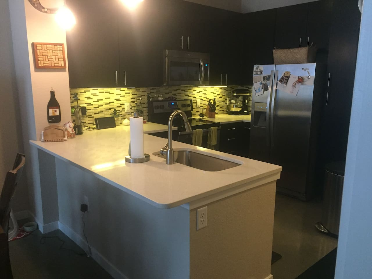 Full kitchen with dishwasher, microwave, and fridge