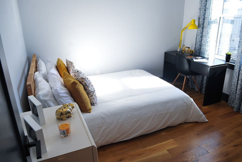 Super comfortable bed and lots of natural sunlight in your private bedroom.