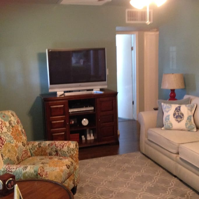 """Large Pottery Barn sofa, recliner, 42"""" TV with dish network.  Also has Roku, a Dave, a DVD player, and many movie dvds, including Disney."""
