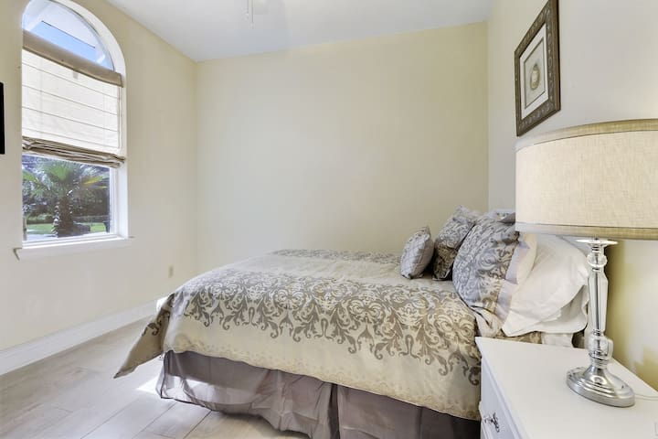 This second bedroom holds a full sized bed, and there is a queen and another full bed on the other side.  Need more room?  There is also a foldaway single bed in the closet.