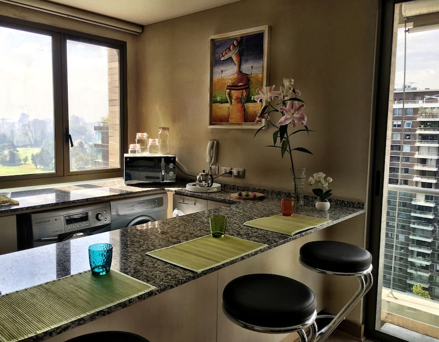Stunning kitchen view of the golf coarse and Andes mountains!
