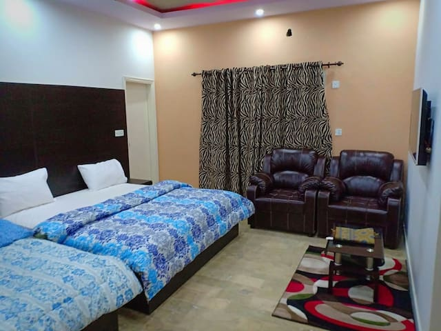 Family Room with attach bath/one double+one single bed/Aircondation/LED TV/ 3 persons can stay easily