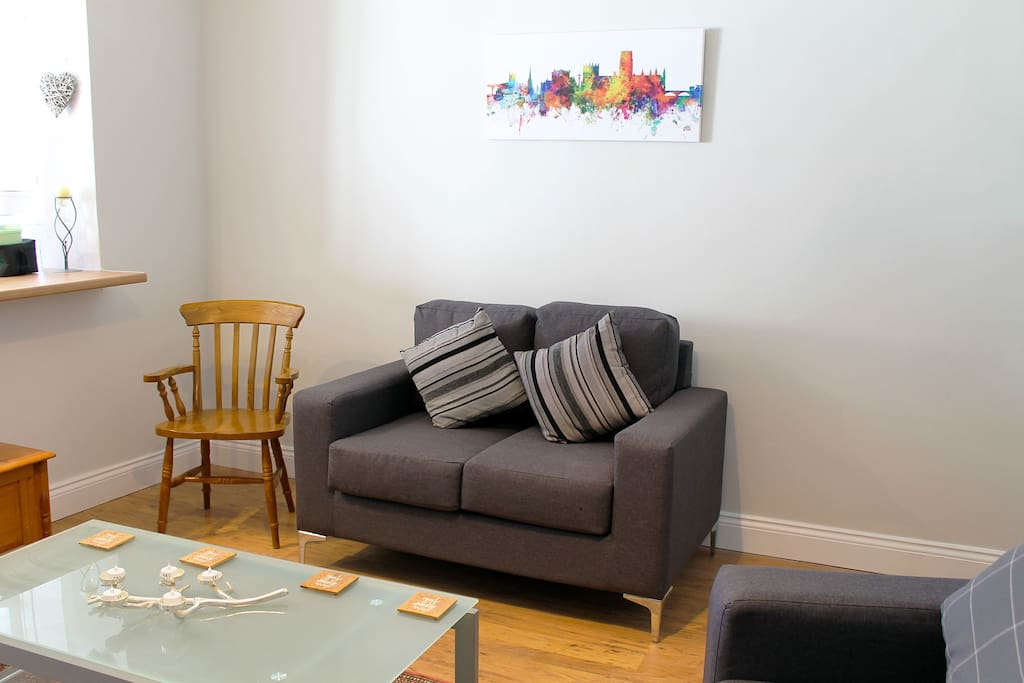 Our comfortable lounge area, with sofas and TV.
