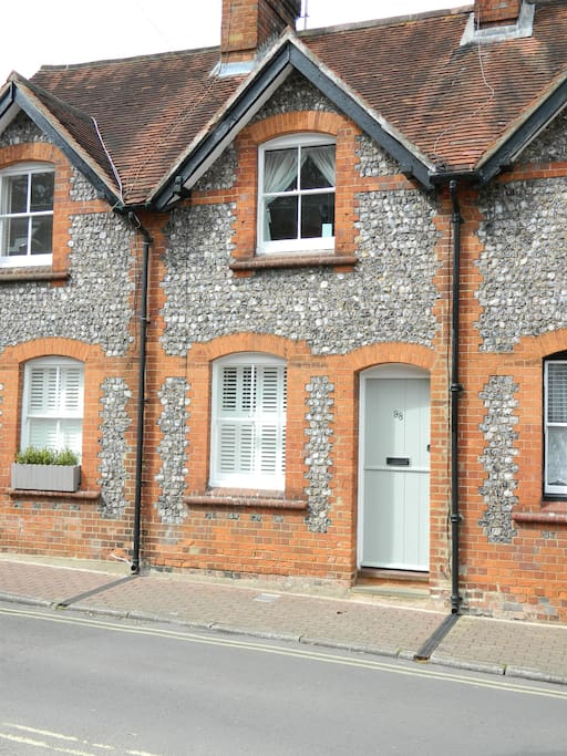 The Victorian brick-and-flint front of the building is grade II listed