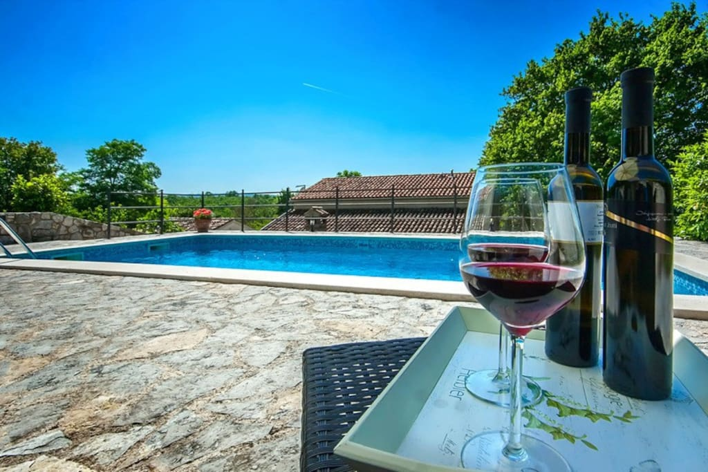 A glass of wine by the pool