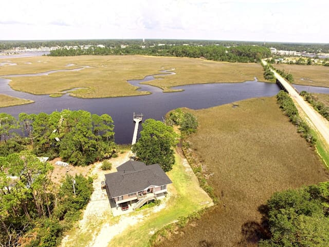 Bayou Breeze is a waterfront house on a private one-acre lot overlooking the Postun Bayou.
