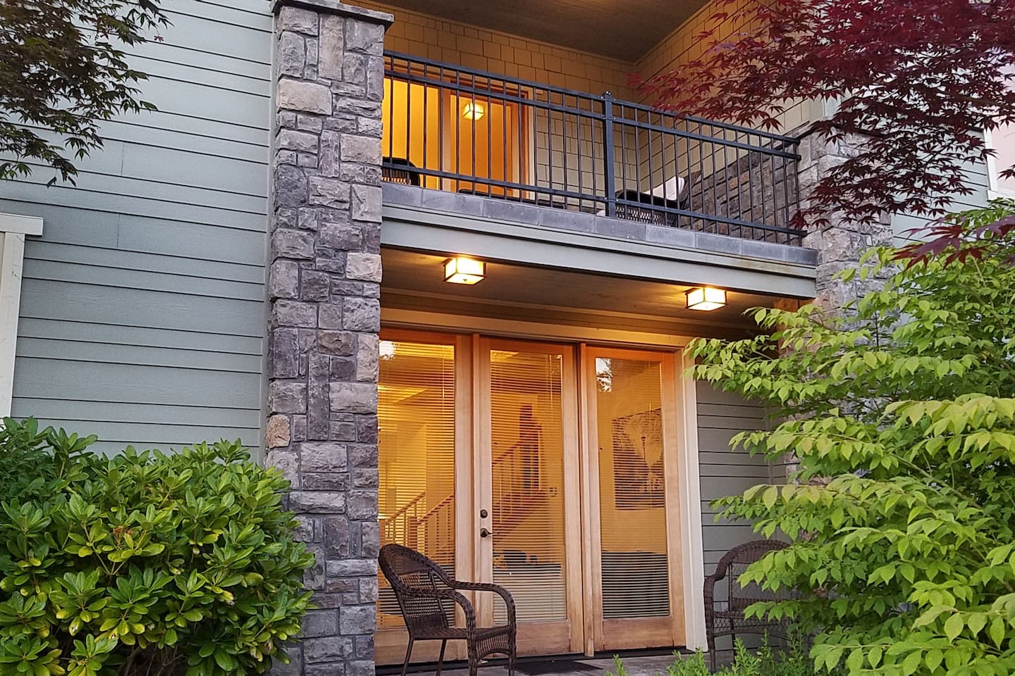 Your own private entrance, which opens to a patio surrounded by landscaping on the cul-de-sac side of our corner lot.