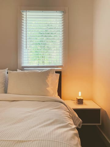 Bedroom Two- each room has high quality mattresses & linens, ample closet space, private workspaces and beautiful views