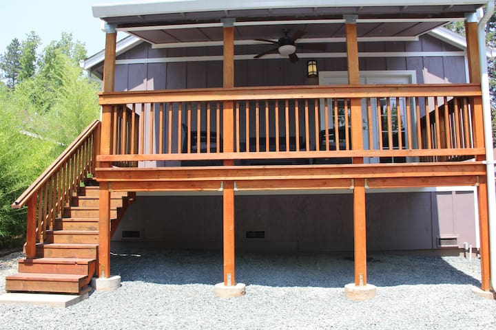Covered deck is perfect for sunny or rainy days.