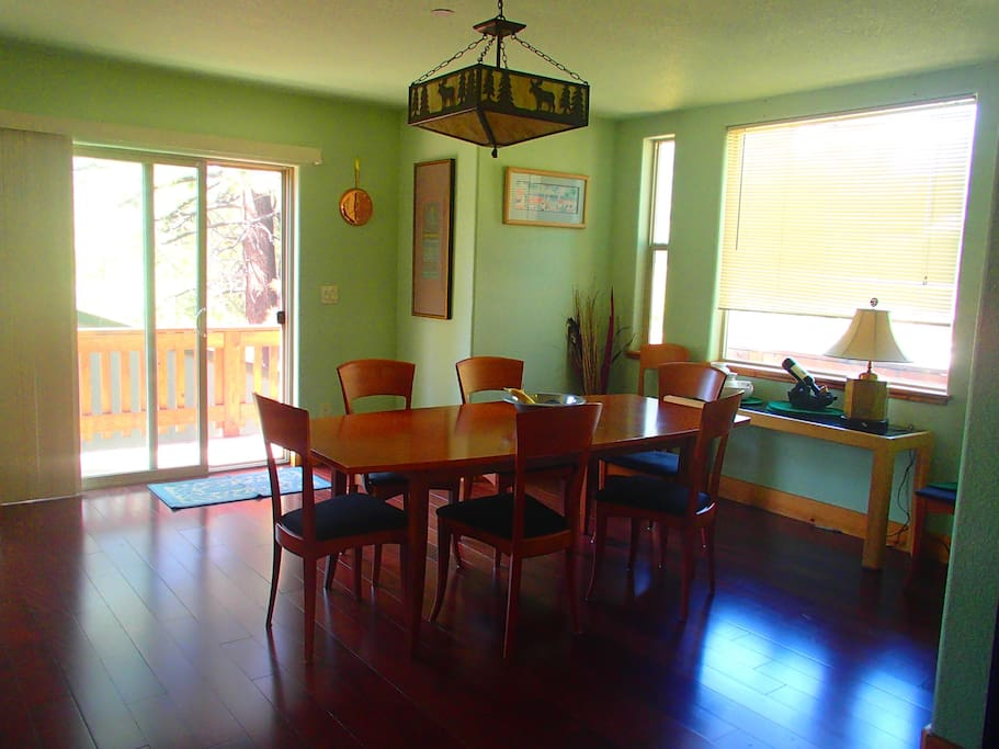 another view of the dining room with slider to deck.