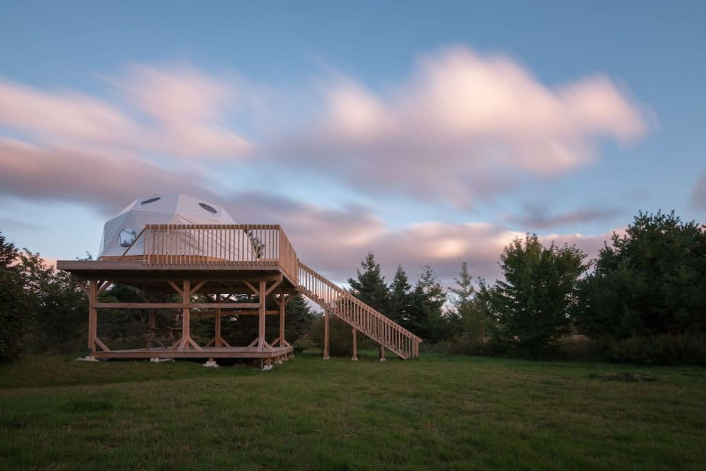 This geodesic dome sits on a treehouse platform in the apple orchard.