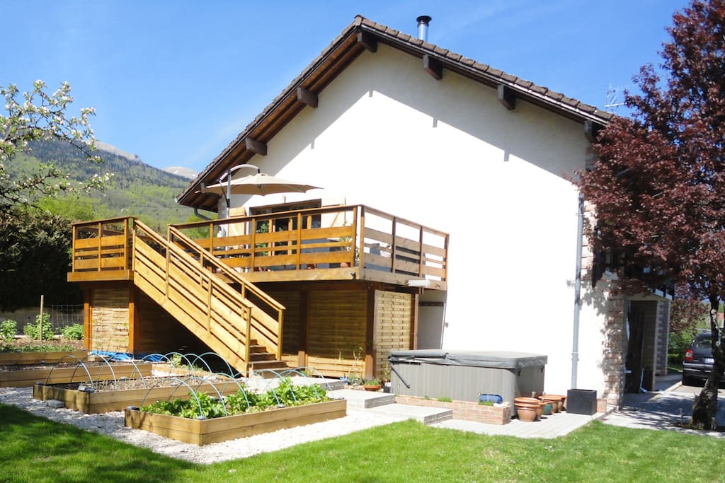 Side of house, Jura mountains behind
