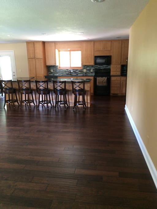 Remodeled kitchen with 5 bar stools
