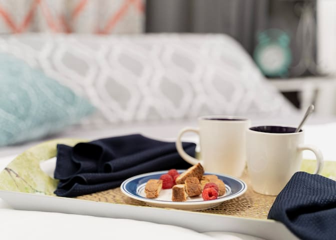 Imagine sharing coffee in a comfy spot just steps beyond the kitchenette. This photo was taken within the first floor Sweet Dreams bedroom. Scroll to see the rest of the room.
