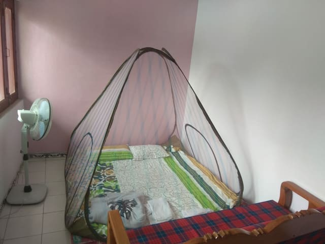 1st  floor:  Sofa with tent-bed .