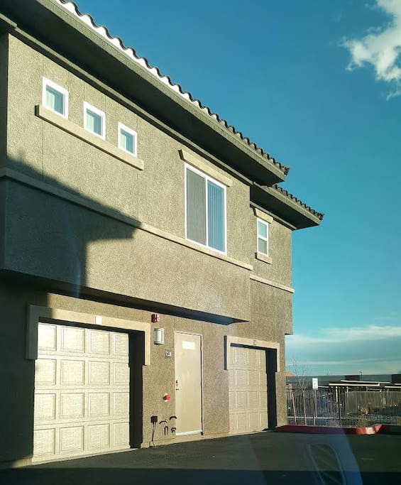 This is the photo of the ACTUAL Unit with BOTH garages. additional  parking also provided.