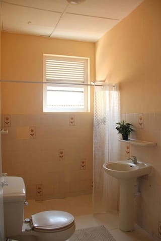 Super clean private bathroom with hot water shower..