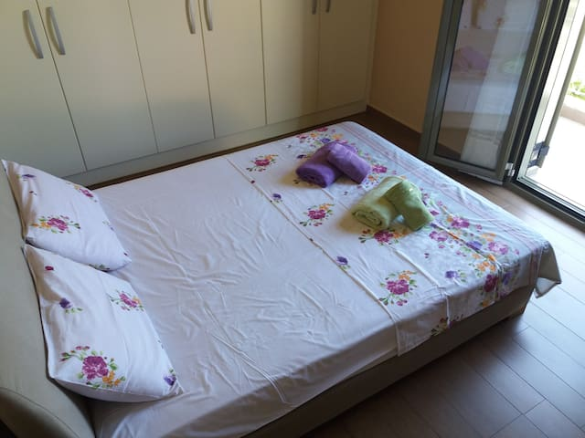 the bedroom with one double bed