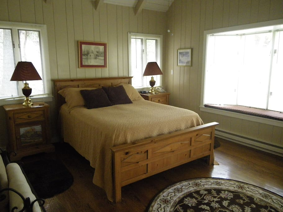 Guests in the master bedroom can enjoy the bay window overlooking the whitewater creek.