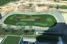 mini golf field seen from the bedroom's window